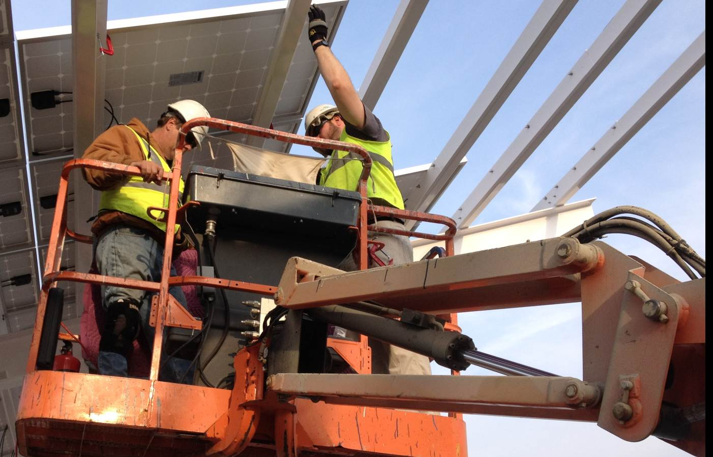 solar panel installation workers on a lift