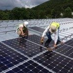 Two Men Installing Commercial Solar PV Array