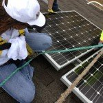 Woman Installing Solar Panel System