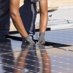 Man Installing Solar PV Panels