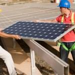 Two Men Installing a Solar Ground Mount