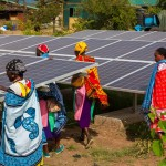 Women near solar array